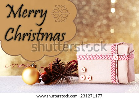Gift box and Christmas decor on table on shiny background - stock photo