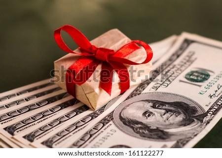 Gift box and US dollar bills - stock photo
