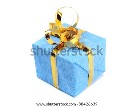 gift box decorated with gold ribbon on a white background. - stock photo