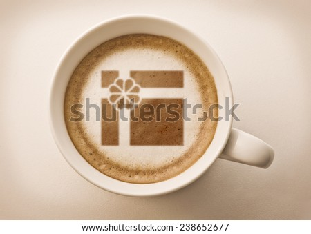 gift box drawing on latte art coffee cup top view - stock photo