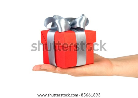 gift box in hand with silver ribbon isolated on white - stock photo