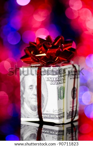gift box made of dollars on blurred background - stock photo