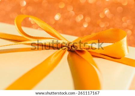 Gift box on bokeh background - stock photo