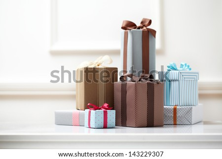 gift box on white table. colorful gifts box. - stock photo