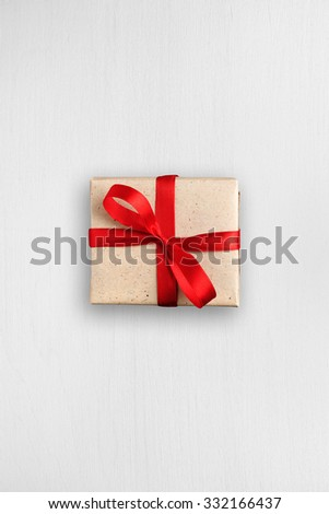 Gift box on white table top view - stock photo