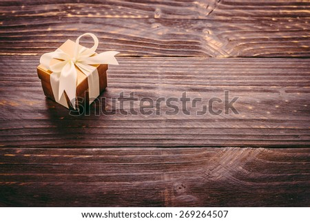 Gift box on wooden background - Vintage effect style pictures - stock photo