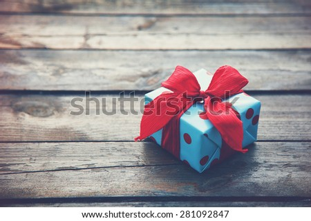 gift box on wooden table as natural background with copyspace - stock photo