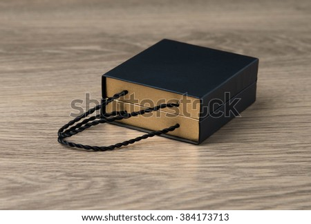gift box on wooden table isolated light background - stock photo