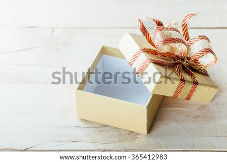 gift box on wooden table,open gift box - stock photo