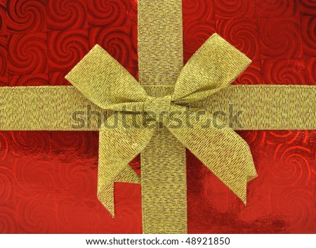 Gift box red package with golden yellow bow - stock photo