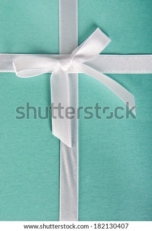 Gift box turquoise with white satin ribbon  - stock photo