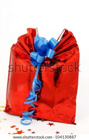 Gift box with a blue ribbon, a present for an important event - stock photo