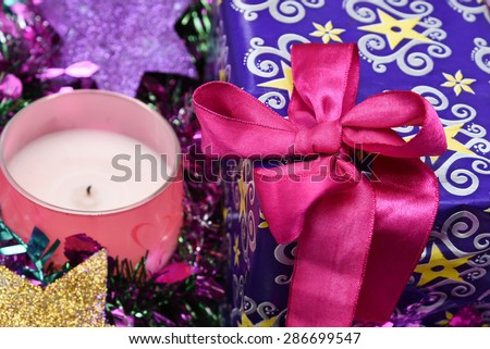 Gift box with bow pink ribbon, Christmas mood. gift for holiday guests - stock photo
