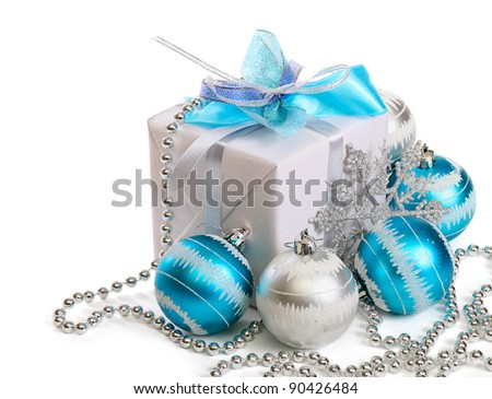 Gift box with Christmas decorations on white background - stock photo