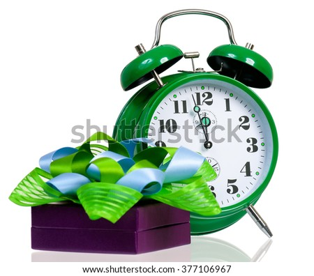 Gift box with green alarm clock, isolated on white background - stock photo