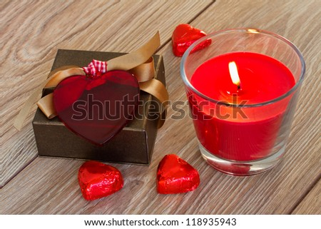 gift box with hearts and red candle for valentines day - stock photo