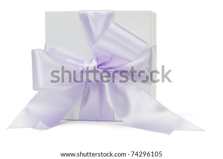Gift box with large purple ribbon lying on its side - stock photo