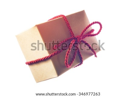 Gift box with red string isolated on white background - stock photo