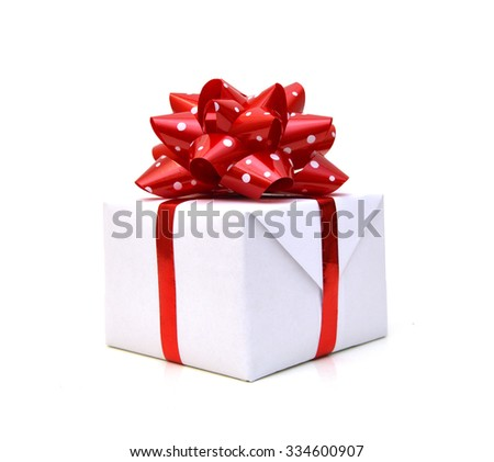 Gift box with ribbon and red bow isolated on the white background, clipping path included. - stock photo