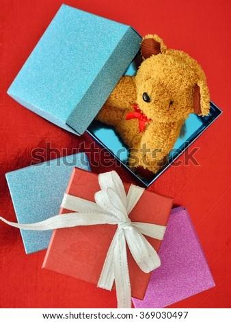 Gift box with teddy bear - stock photo