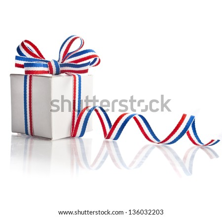 gift box wrapped striped red blue ribbon tape isolated on white background - stock photo