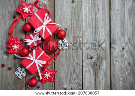Gift boxes and snowflakes on wooden background - stock photo