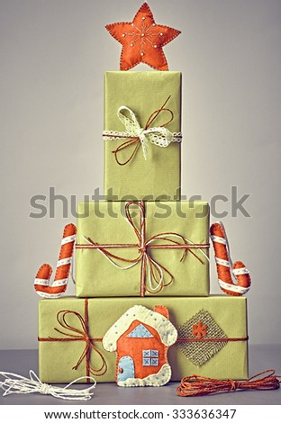 Gift boxes like fir tree. Christmas, candy cane house and star. Kraft paper bows ribbons lace. Festive creative New Year. Retro, vintage, greeting card, party decoration handmade, closeup - stock photo