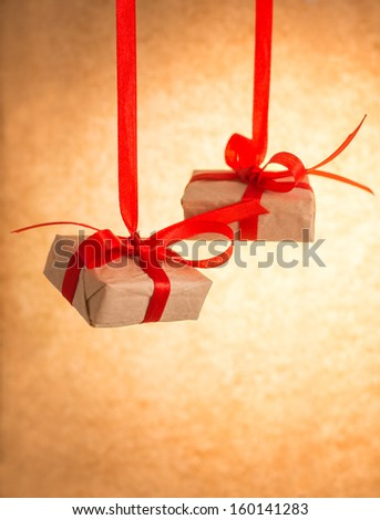 Gift boxes on old paper background - stock photo