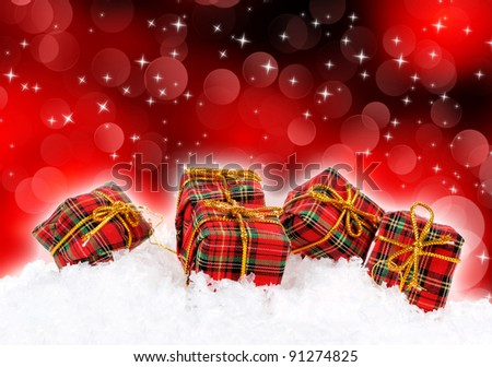Gift boxes over red background - stock photo