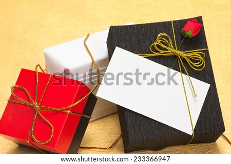 Gift boxes with a card and paper flower - stock photo