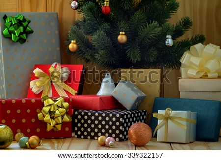 Gift boxes with Christmas on wooden background - stock photo