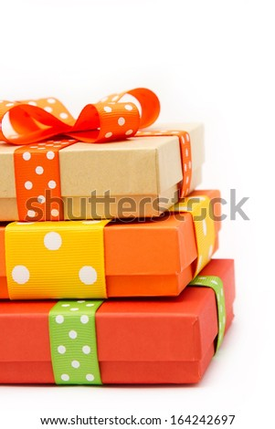 Gift boxes with colorful dotted ribbons - stock photo