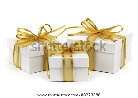 Gift boxes with golden ribbon bow,isolated on white. - stock photo