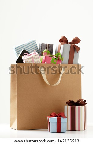 Gift boxes with shopping bag. Group of presents. white background. - stock photo