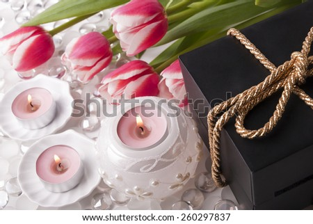 Gift, candles and tulips - stock photo