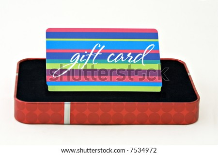 Gift card displayed in a gift box isolated on a white background - stock photo