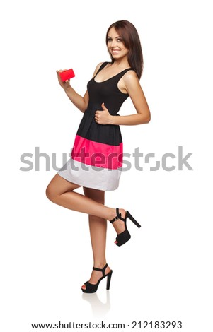 Gift card. Excited woman in full length showing empty blank paper card sign with copy space for text and gesturing thumb up, isolated on white background. - stock photo