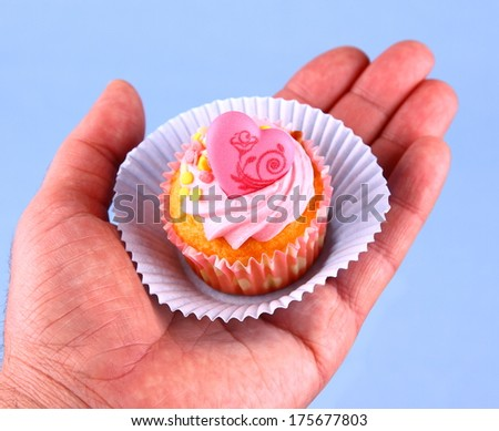 Gift for Valentine's Day, cup cakes on hand - stock photo