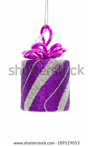 Gift in shiny packaging, Christmas toy on a white background.  - stock photo