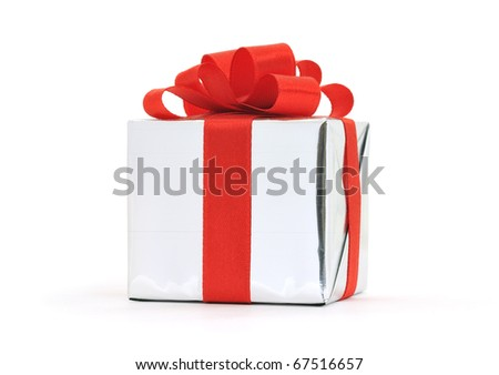 Gift in silver wrapping with red bow isolated on white background - stock photo