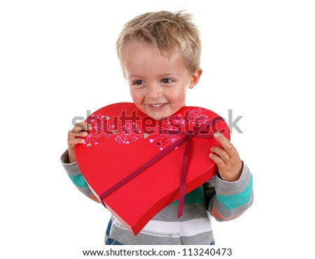 Gift of chocolates in heart shaped box from a young boy - stock photo