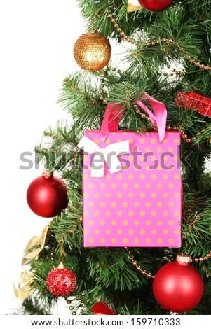 Gift on Christmas tree isolated on white - stock photo