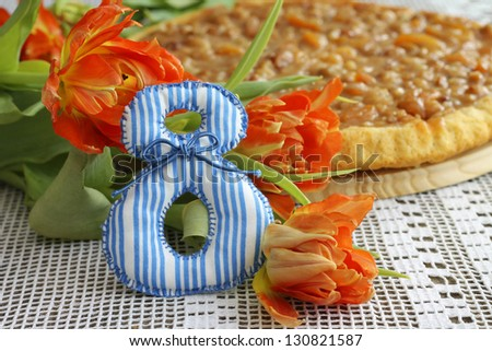 Gift on March 8 - tulips with tart, close-up - stock photo