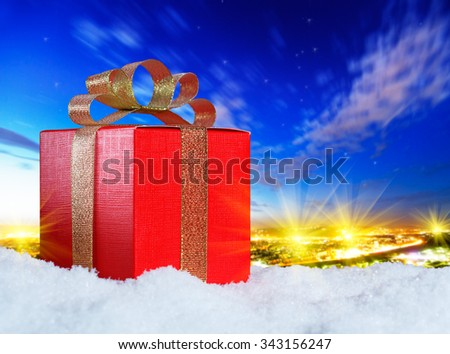 gift on snow in the night sky - stock photo