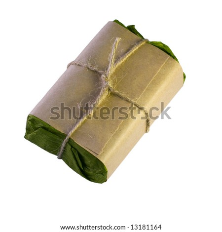 Gift packaged in green and brown paper isolated on white background - stock photo