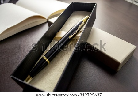 gift pen  in box / selective focus / filter vintage. - stock photo