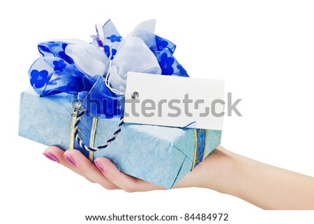 gift with a business card in his hand - stock photo