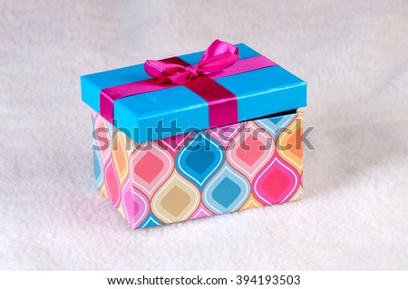 gift with a ribbon and bow - stock photo