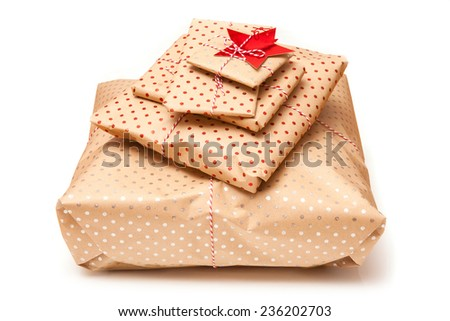 Gift wrapped parcels or presents isolated on a white studio background. - stock photo