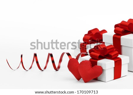 Gifts boxes with red ribbons and textile hearts, valentines day concept - stock photo